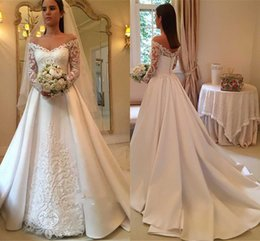 Chinese  2018 Elegant White A-Line Wedding Dresses Off-Shoulder Long Sleeve Lace Appliques Sexy Back Button Bridal Dresses Charming Wedding Gowns manufacturers