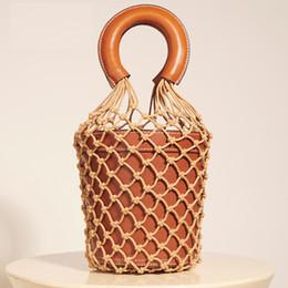 $enCountryForm.capitalKeyWord NZ - DSAKGTE Women Nets Bucket Handbags Retro Crochet Straw Beach Bag Hollow Out Barrel Leather Bao Bao Fish Tote Basket Bag Purse
