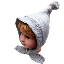 Discount beanies hats for kids - Winter Knitted Bomber Hats For Kids Children Tassel Pompom Ball Trapper Cap Baby Warm Fleece Earflap Beanies Hat