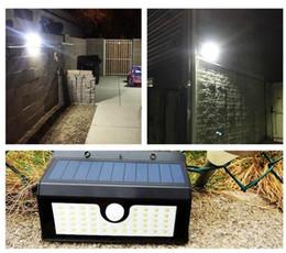 Venta al por mayor de Panel super brillante LED de seguridad contra inundaciones Luz solar para jardín Sensor de movimiento PIR 45 LEDs Camino Lámparas de pared Luz de inundación de emergencia al aire libre Lámpara