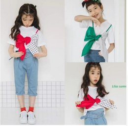 Wholesale Children s clothing summer new girls cotton short sleeved T shirt hit color fake two large bow shirt T shirt