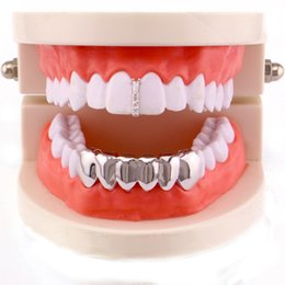 $enCountryForm.capitalKeyWord NZ - Factory Bottom Price Teeth Grillz Men Copper Jewelry Hip Hop Grillz Real Gold Plated Accesory Dental Grills Wholesale Halloween Vampire Gift