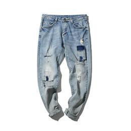 Chinese  2018 Summer Classic Korean Holes Cowboy Self-cultivation Pocket Pencil Pants Slim Baggy Homme Men Blue Jeans Plus Size 28-33 manufacturers
