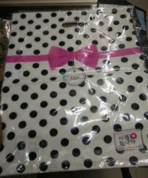 Ingrosso 25 * 35cm Dot Bow tie Patterns Plastica Grande imballaggio in plastica regalo borsa Pantaloni Shopping Bags 100pcs