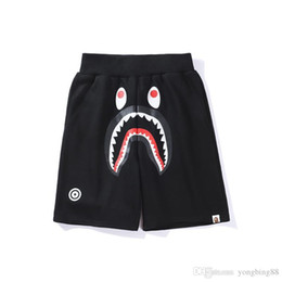 Wholesale beach pants for short women online – Famous Brand Ape Beach shorts Cartoon Printed Shark head WGM Off Men Women Leisure pants White for Summer