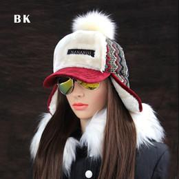 e08284c00de Winter Faux Cashmere Bomber Hat Women Earflap Caps Faux Fur Pompom Snow Hats  Adjustable Bohemian Winter Russian Ushanka C18110801