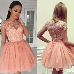Wholesale 2018 Sexy Coral Girl Homecoming Dresses Sheer Jewel Neck Long Sleeves Peach Lace Applique Sequins Prom Party Plus Size Cocktail Gowns