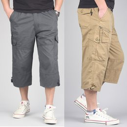 e8a0bb623bf Men Summer Beach Shorts Tactical Trousers Cargo Multi Pocket Man Loose  Climbing Trekking Beach Trousers Plus Size