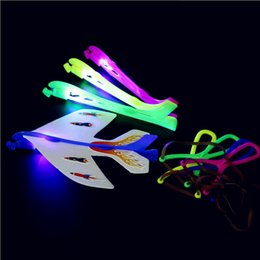 Wholesale Toys Helicopter NZ - Novelty Luminous Plane Children Toys LED Flying Arrow Helicopter Slingshot Birthday Gift Supplies Outdoor Games for Kids NNA432