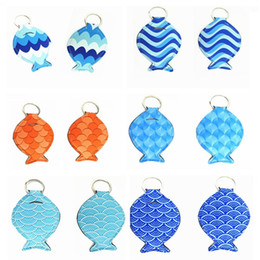 Car Key Sleeves NZ - Fashionable personality earphone sleeve fish-shaped key ring Euramerican pop Small pendant for daily use Keychains T5C002
