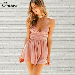 3694628c2439 CWLSP Bow Backless White Pink Mono Print Lace Playsuit for Lady Summer Sexy  Loose Bodysuits Women Beach Short Jumpsuit QL3639