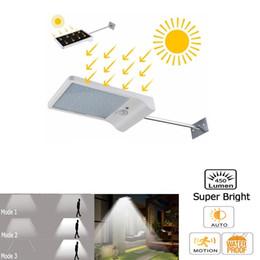 Discount patio walls - PIR Motion Sensor LED Wall lamp Solar Power Outdoor Night light For Street Garden Door Path Yard Path Fence Patio Securi