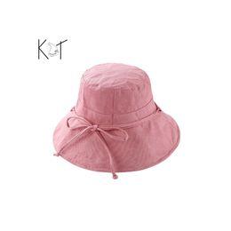 2018 algodón lino pescador sombrero señora ala grande bowknot sol sombra  color sólido viajes de verano 9de05e6a64c
