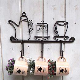 $enCountryForm.capitalKeyWord NZ - Hot Sale Creative Iron Hook Garden Home Decoration Cartoon Cup Shape Hat Rack Clothes Hanger Black Fashion Iron Ear Clasp 1 Pcs