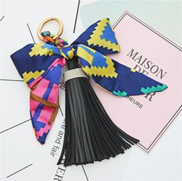 $enCountryForm.capitalKeyWord Canada - Bowknot Key chain Fashion Satin Silk Bowknot PU leather Tassel Key chain Pendants Key ring For Women Bags Decoration Charm Pendant NEW 2018