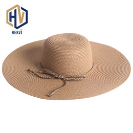 367a75e5551 Top Brand Wholesale Big Wide Brim Floppy Summer Hat Women UV Protect Travel  Sun Shade Cap Female Beach Straw Hats NS46-A