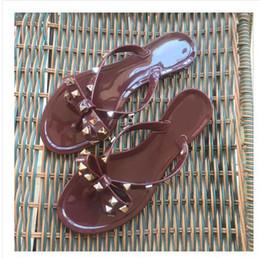 Women Flat Booties Canada - 2018 new European and American rivet flat shoes bow flip-flops women jelly clip toe beach sandals female