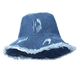 Summer Washed Denim Sun Hat Women Fashion Tassel Floppy Cap Ladies Wide  Brim Beach Bucket Hats Female Cotton foldable Chapeu 6bc7f0b5d6b8