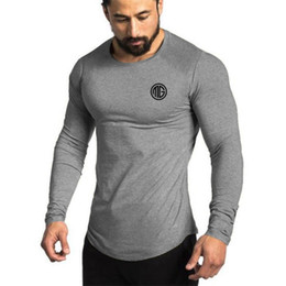 China Muscleguys Brand 2018 Fashion Clothes Solid Color Long Sleeve Slim Fit T Shirt Men Cotton Casual T-Shirt Sportswear Gyms Tshirts cheap gym clothes wholesale suppliers
