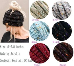 online shopping 2017 New Trendy CC Warm Winter Hat For Women Ponytail Beanie Stretch Cable Knit Messy Bun Hats Soft Ski Cap