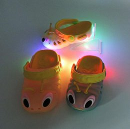holed shoes Australia - 2019 Child cool sandals summer caterpillar shoes men and women child shoes baby flashing lights sandals hole slippers su