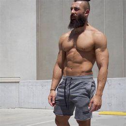 $enCountryForm.capitalKeyWord NZ - Summer Shorts White Men Running Shorts Fitness Body building Men Workout Sport Joggers Gym Sweatpants black Trousers