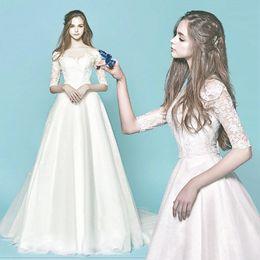 bda11719f Grace White Tulle Bateau Media manga apliques Una línea de vestidos de novia  Vestidos de novia Vestidos de novia por encargo Tamaño 2-18 KW312001