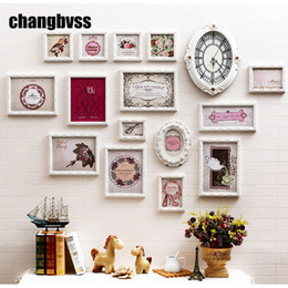 photo frame styles NZ - European Style White  Pink Solid Wood Carved Frames Home Decor 15 pcs set Photo Frame +One Clock Wall Hanging Picture Frame Set