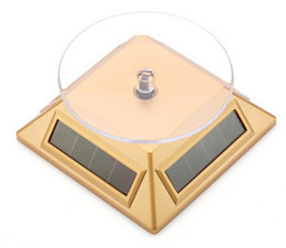$enCountryForm.capitalKeyWord Canada - Jewelry Dispaly platform Exhibition Stand Solar Auto Rotating Display Stand Rotary Turn Table Plate For mobile MP4 Watch jewelry VIP Store