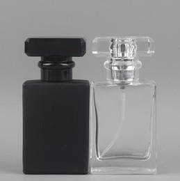 Venta al por mayor de 30 ml de viaje portátil botella de vidrio transparente botellas vacías atomizador de aerosol recargable botella negro transparente