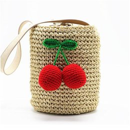 Single Hair Weave UK - Cherry Pompon Summer Style Cylinders Handbags Bohemian Boho Indian Hair Straw Bag Thai Woven Beach Bag