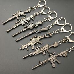 $enCountryForm.capitalKeyWord Canada - 2018 Hot Game 16 Styles PUBG CS GO Weapon Keychains AK47 Gun Model 98K Sniper Rifle Key Chain Ring for Men Gifts Souvenirs 6CM