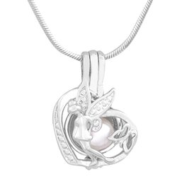 China New Design Love Wish Pearl Angel of Mercy Cage Pendant Pearl Gem Bead Locket Pendant Mounting DIY Charms Accessory P189 cheap animal mounts wholesale suppliers