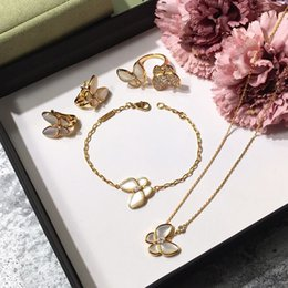 IndIan gold pearl necklace sets online shopping - Brand silver four leaf flower jewelry set for women wedding necklace bracelet earrings ring Butterfly clover mother shell CZ jewelry