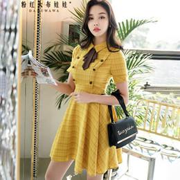 c3a7c5b11ee7 Dabuwawa 2018 New OL Style Fashion Trim Waistline Bow Tie Shirt Collar  Plaid Summer Women Dress