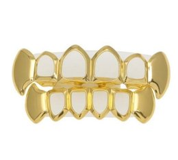 dental gold teeth UK - hot sale new arrival THE BLING KING Teeth Dental Drip Grills Sets Top Bottom Vampire Hip Hop Punk Caps Set Gold Silver Color Plated