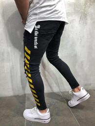 Discount man style slim long pants - Mens Black Ripped Denim Pants Yellow Strips Fashion Jeans Man Slim High Street Jeans Free Shipping