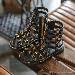 Vente en gros Hot vente mode estivale filles romaines sandales High-top enfants sandales bébé sandales bébé haute qualité à bout ouvert Rivet chaussures