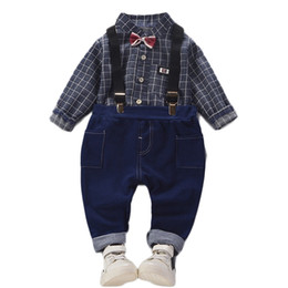 Discount baby boy red plaid shirt Autumn new children's gentleman clothing sets baby boys plaid tops + bib pants 2 pcs suit fashion bow shirt clothes