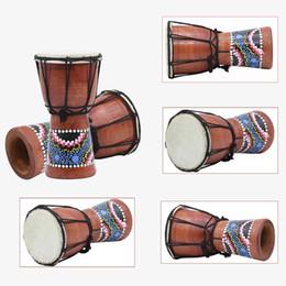 Venta al por mayor de Tambor pequeño africano Tambor de mano pequeño de cuatro pulgadas tambor de mano para adultos Práctica hecha a mano 18x12.7 cm