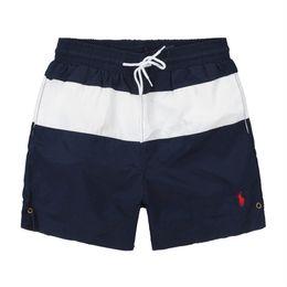 9b9da446b50 Envío gratis hombres pantalones cortos de sarga de ocio impreso deportes de  los hombres de alta calidad pantalones de playa trajes de baño Bermudas  letra ...