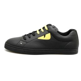 Fashionable Flat shoes laces online shopping - High quality leather small monster yellow eyes black and white casual shoes luxury designer s fashionable flat tie sports shoes