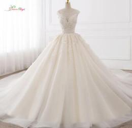 66d09fb118 Dream Angel Vestido De Noiva Sexy Backless una línea de vestidos de novia  2018 apliques de encaje Royal Train Tulle vestidos de novia más tamaño