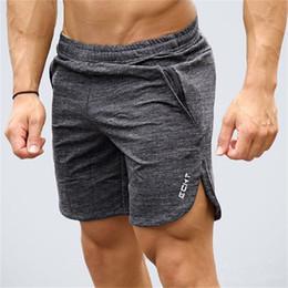 Short de gymnastique en coton pour hommes Cours de jogging Sports Fitness Bodybuilding Pantalons de survêtement Profession masculine entraînement Crossfit Marque Pantalon court en Solde