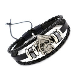 plastic silicone UK - Foreign Trade Jewelry Wholesale Alloy Skeleton head hand Decoration Personality punk woven Real leather bracelet Men's bracelet