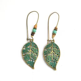 blue leaves earrings 2019 - Anti-allergy Europe exaggerated retro new earrings, hollow leaves beads pendant earrings wholesale cheap blue leaves ear