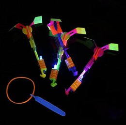 Helicopter slingsHot toys online shopping - Novelty Children Toys Amazing LED Flying Arrow Helicopter for Sports Funny Slingshot birthday party supplies Kids Gift