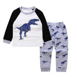 China Baby Boy Dinosaur Suits Designer Clothes Printing Black Long Sleeve White Patchwork Elastic Waist Cartoon Fashion Splicing Kids Clothing Set suppliers