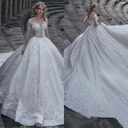 Chinese  2019 Luxurious Long Sleeve Sheer Neck Ruffle Applique Lace Wedding Dresses Hollow Zipper Back Long Tail Bridal Gown Free Ship manufacturers