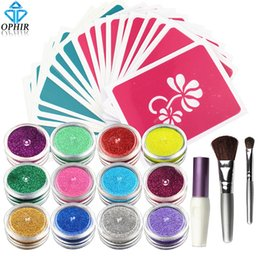 stencil painting designs Australia - OPHIR 12x Shimmer Powder Temporary Glitter Tattoo Set for Body Art Paint with Body Glue 20 Designs Stencil & 2x Brushes_TA060